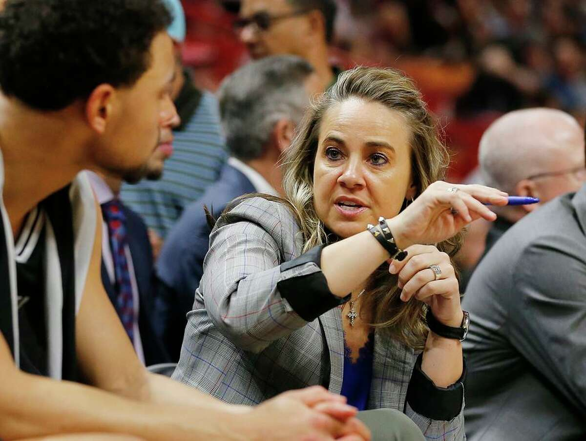 MIAMI, FLORIDA - JANUARY 15: Assistant coach Becky Hammon of the San Antonio Spurs talks with Bryn Forbes #11 against the Miami Heat during the first half at American Airlines Arena on January 15, 2020 in Miami, Florida. NOTE TO USER: User expressly acknowledges and agrees that, by downloading and/or using this photograph, user is consenting to the terms and conditions of the Getty Images License Agreement. (Photo by Michael Reaves/Getty Images)