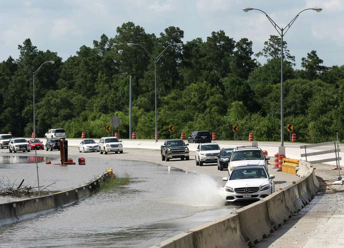 Rising flood water begins to creep onto the Hardy Toll Road where it intersects with the Grand Parkway, along Saturday, May 28, 2016, in Spring. ( Jon Shapley / Houston Chronicle )
