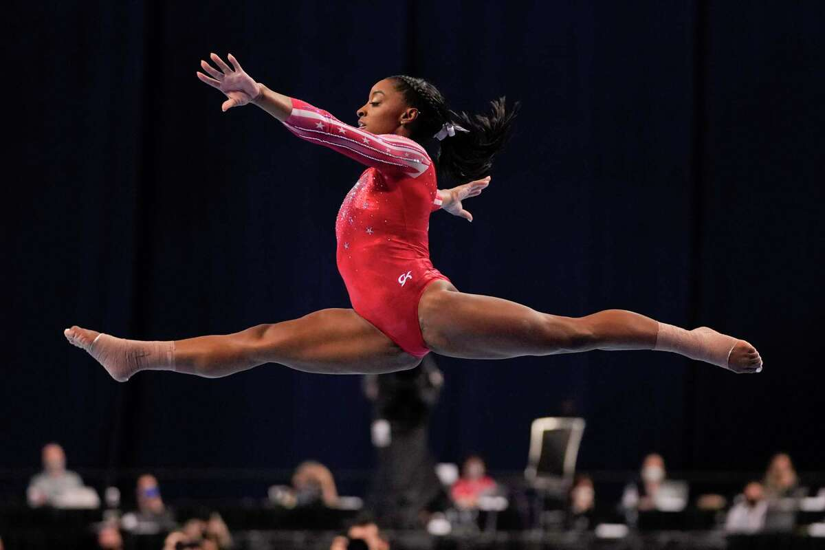 Simone Biles competes in the floor exercise during the women's U.S. Olympic Gymnastics Trials Sunday, June 27, 2021, in St. Louis. (AP Photo/Jeff Roberson)