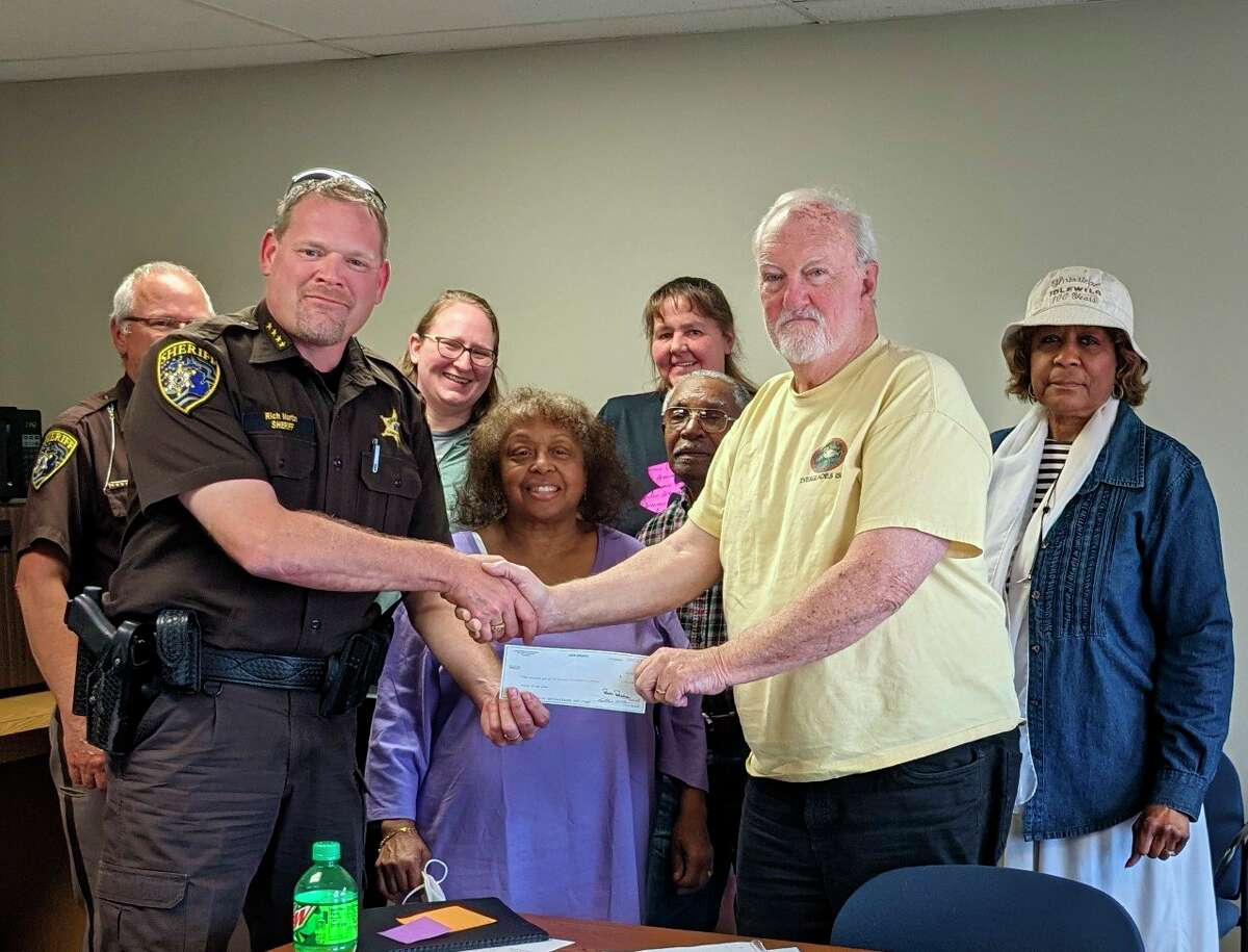 Lake County Sheriff Rich Martin presented the board of directors of the Shrine of the Pies Museum with a donation of $1000 from the Sheriff's Charity Campaign. (Submitted photo)