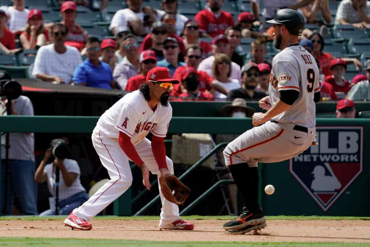 San Francisco Giants' Brandon Belt, right, makes it to third on a single by Donovan Solano as Los Angeles Angels third baseman Luis Rengifo misses the throw during the eighth inning of a baseball game Wednesday, June 23, 2021, in Anaheim, Calif. (AP Photo/Mark J. Terrill)