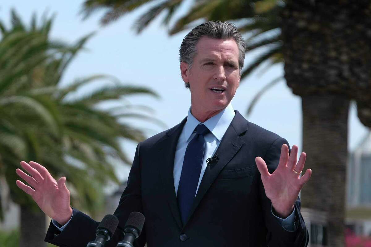 California Gov. Gavin Newsom speaks during a news conference at Universal Studios. Lawmakers are poised to approve a $5.2 billion rent relief program to avert mass evictions by extending the state's eviction moratorium through September.
