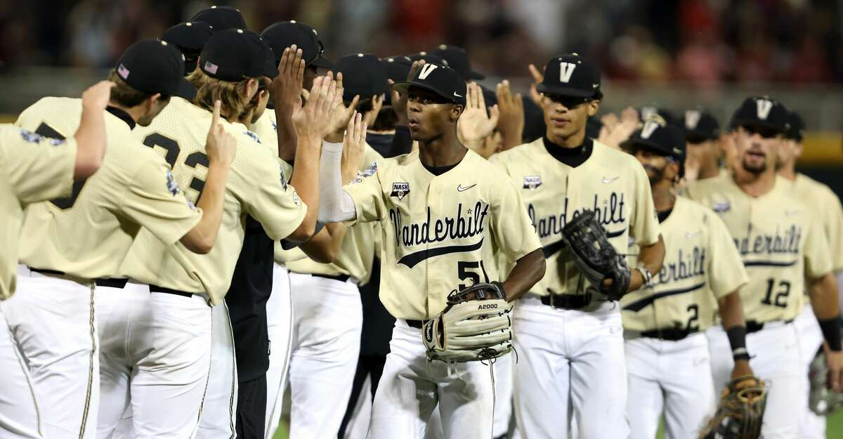 Enrique Bradfield Jr. #51 of the Vanderbilt celebrates with teammates after defeating the Mississippi St. Bulldogs 8-2 in game one of the College World Series Championship at TD Ameritrade Park Omaha on June 28, 2021 in Omaha, Nebraska. (Photo by Sean M. Haffey/Getty Images)