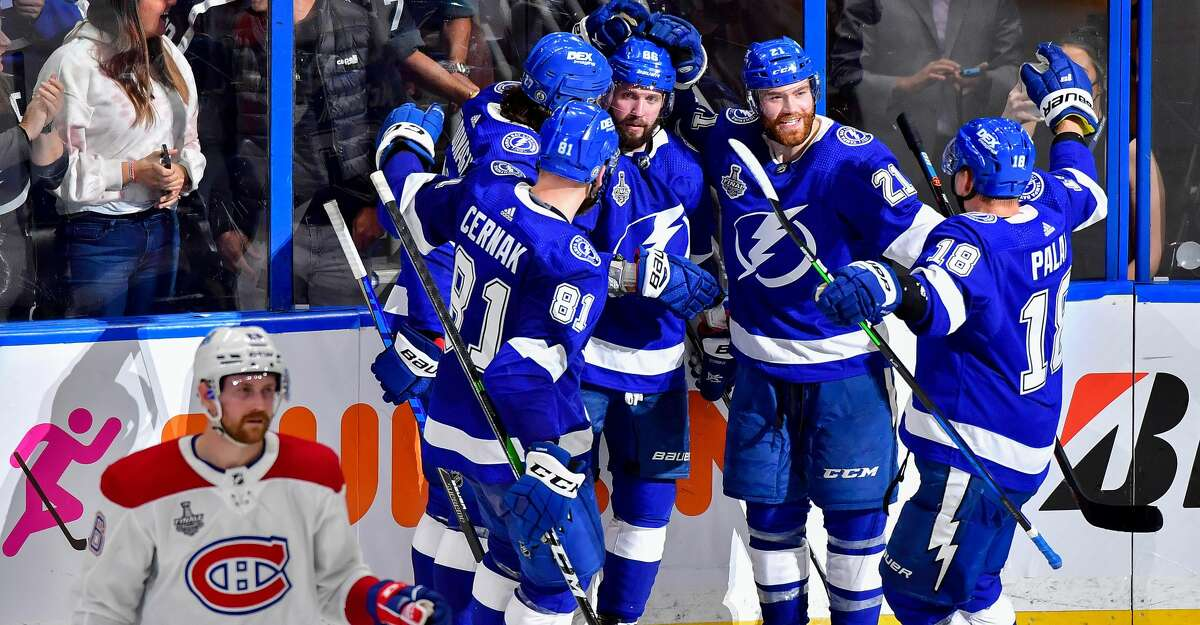 Nikita Kucherov #86 of the Tampa Bay Lightning is congratulated by his teammates after scoring a goal against the Montreal Canadiens during the third period in Game One of the 2021 NHL Stanley Cup Final at Amalie Arena on June 28, 2021 in Tampa, Florida. (Photo by Julio Aguilar/Getty Images)