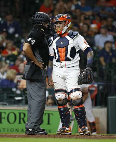 Houston Astros catcher Martin Maldonado (15) has a conversation with home plate umpire Kerwin Danley (44) during the seventh inning of an MLB baseball game at Minute Maid Park, Monday, June 28, 2021, in Houston. Photo: Karen Warren/Staff Photographer / @2021 Houston Chronicle