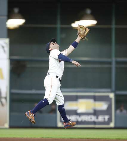 Houston Astros second baseman Jose Altuve (27) reaches for Baltimore Orioles Austin Hays'pop ball single during the seventh inning of an MLB baseball game at Minute Maid Park, Monday, June 28, 2021, in Houston. Photo: Karen Warren/Staff Photographer / @2021 Houston Chronicle