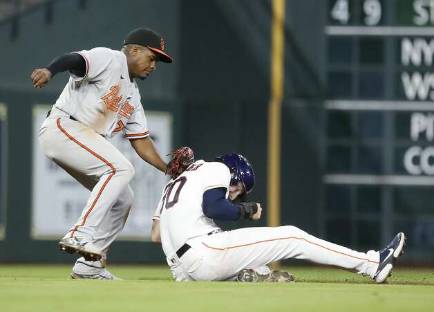 Houston Astros Kyle Tucker (30) gets caught in a rundown by Baltimore Orioles third baseman Domingo Leyba (75) during the sixth inning of an MLB baseball game at Minute Maid Park, Monday, June 28, 2021, in Houston. Photo: Karen Warren/Staff Photographer / @2021 Houston Chronicle