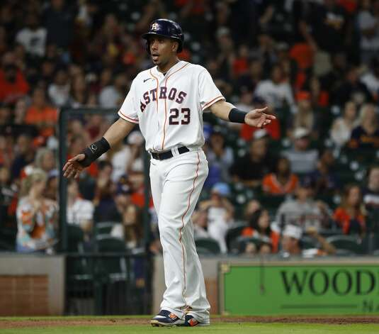 Houston Astros Michael Brantley (23) shrugs his shoulders after scoring a run on Kyle Tucker's walk with the bases loaded during the seventh inning of an MLB baseball game at Minute Maid Park, Monday, June 28, 2021, in Houston. Photo: Karen Warren/Staff Photographer / @2021 Houston Chronicle