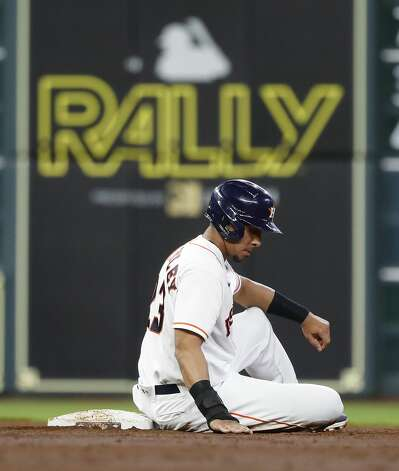 Houston Astros Michael Brantley (23) sits on second base after Yuli Gurriel ground into a double play to end the third inning of an MLB baseball game at Minute Maid Park, Monday, June 28, 2021, in Houston. Photo: Karen Warren/Staff Photographer / @2021 Houston Chronicle