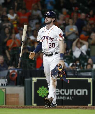 Houston Astros Kyle Tucker (30) flips his bat as he was walked by Baltimore Orioles Tanner Scott which allowed Michael Brantley to score a run as the bases were loaded during the seventh inning of an MLB baseball game at Minute Maid Park, Monday, June 28, 2021, in Houston. Photo: Karen Warren/Staff Photographer / @2021 Houston Chronicle
