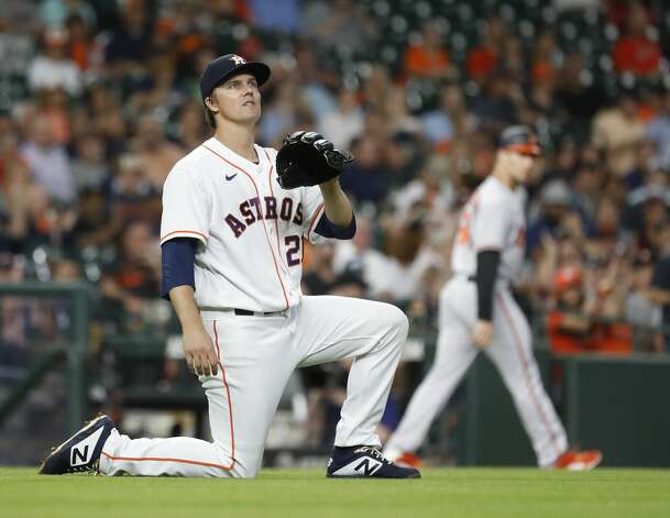 Houston Astros starting pitcher Zack Greinke (21) on his knees as he watched Baltimore Orioles Ramon Urias (29) ground into a double play during the fourth inning of an MLB baseball game at Minute Maid Park, Monday, June 28, 2021, in Houston. Photo: Karen Warren/Staff Photographer / @2021 Houston Chronicle