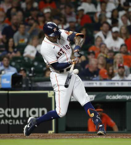 Houston Astros shortstop Carlos Correa (1) singles during the fourth inning of an MLB baseball game at Minute Maid Park, Monday, June 28, 2021, in Houston. Photo: Karen Warren/Staff Photographer / @2021 Houston Chronicle
