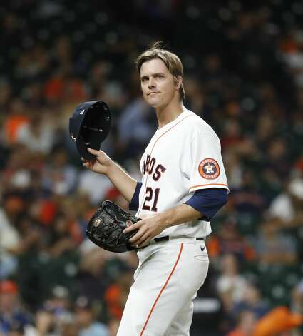 Houston Astros starting pitcher Zack Greinke (21) takes off his hat as he prepared to be inspected by home plate umpire Kerwin Danley after the fifth inning of an MLB baseball game at Minute Maid Park, Monday, June 28, 2021, in Houston. Photo: Karen Warren/Staff Photographer / @2021 Houston Chronicle
