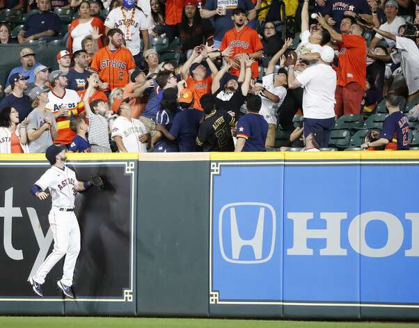 Houston Astros right fielder Kyle Tucker (30) looks into the right field stands as fans scramble to catch Baltimore Orioles Ryan Mountcastle's home run ball hit off of Houston Astros starting pitcher Zack Greinke during the fifth inning of an MLB baseball game at Minute Maid Park, Monday, June 28, 2021, in Houston. Photo: Karen Warren/Staff Photographer / @2021 Houston Chronicle
