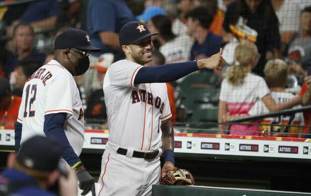 Houston Astros shortstop Carlos Correa (1) gives the thumbs up to someone in the stands before the start of the first inning of an MLB baseball game at Minute Maid Park, Monday, June 28, 2021, in Houston. Photo: Karen Warren/Staff Photographer / @2021 Houston Chronicle