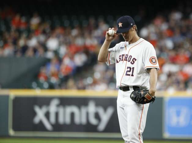 Houston Astros starting pitcher Zack Greinke (21) between pitches during the first inning of an MLB baseball game at Minute Maid Park, Monday, June 28, 2021, in Houston. Photo: Karen Warren/Staff Photographer / @2021 Houston Chronicle