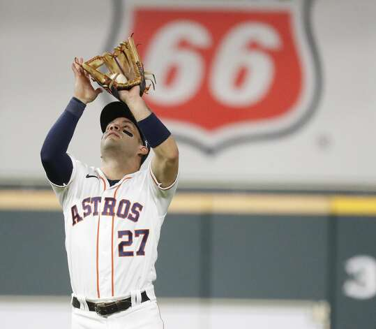 Houston Astros second baseman Jose Altuve (27) catches Baltimore Orioles Pat Valaika's pop out during the third inning of an MLB baseball game at Minute Maid Park, Monday, June 28, 2021, in Houston. Photo: Karen Warren/Staff Photographer / @2021 Houston Chronicle