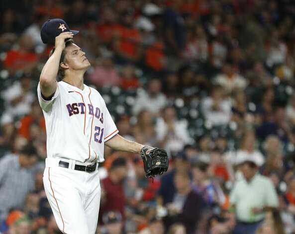 Houston Astros starting pitcher Zack Greinke (21) reacts after Baltimore Orioles Austin Hays scored a run on Ryan Mountcastle's single during the third inning of an MLB baseball game at Minute Maid Park, Monday, June 28, 2021, in Houston. Photo: Karen Warren/Staff Photographer / @2021 Houston Chronicle