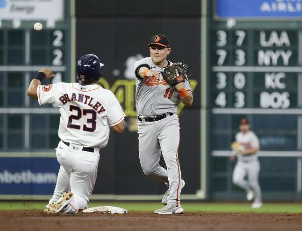 Baltimore Orioles second baseman Pat Valaika (11) makes the throw to first base after tagging Houston Astros Michael Brantley (23) out at first as Yuli Gurriel ground into a double play to end the third inning of an MLB baseball game at Minute Maid Park, Monday, June 28, 2021, in Houston. Photo: Karen Warren/Staff Photographer / @2021 Houston Chronicle