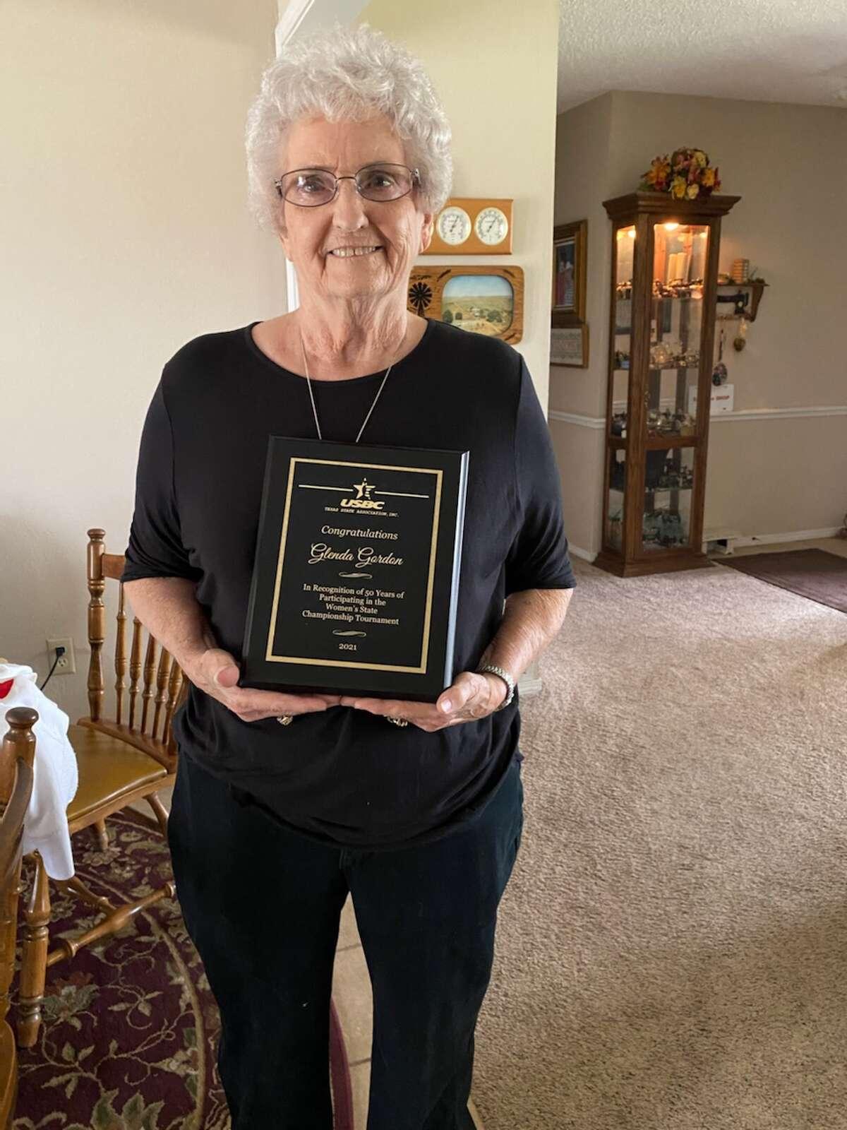 Former longtime Plainview resident Glenda Gordon holds her plaque commemorating 50 Texas Women's Bowling Association state tournaments.