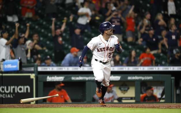 Houston Astros Jose Altuve (27) hits a long sacrifice fly with the bases loaded during the ninth inning of an MLB baseball game at Minute Maid Park, Monday, June 28, 2021, in Houston. Photo: Karen Warren/Staff Photographer / @2021 Houston Chronicle