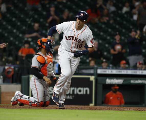 Houston Astros Jason Castro (18) is walked by Baltimore Orioles relief pitcher Adam Plutko to load the bases during the ninth inning of an MLB baseball game at Minute Maid Park, Monday, June 28, 2021, in Houston. Photo: Karen Warren/Staff Photographer / @2021 Houston Chronicle