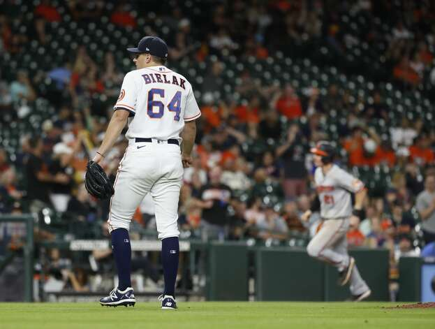 Houston Astros relief pitcher Brandon Bielak (64) reacts after giving up a two-run home run to Baltimore Orioles Austin Hays during the ninth inning of an MLB baseball game at Minute Maid Park, Monday, June 28, 2021, in Houston. Photo: Karen Warren/Staff Photographer / @2021 Houston Chronicle