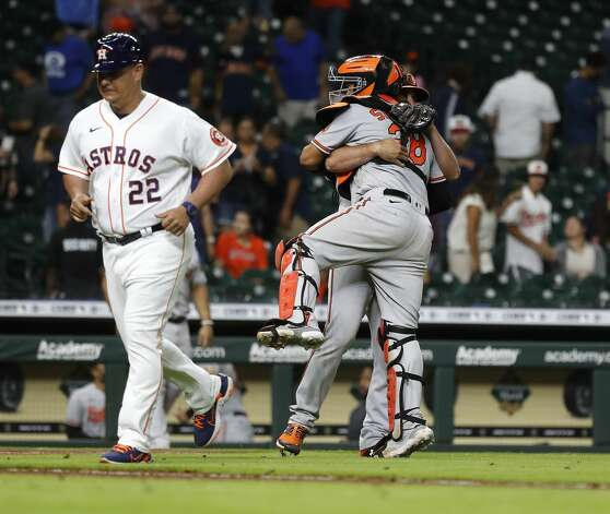 Baltimore Orioles catcher Pedro Severino (28) and relief pitcher Adam Plutko (35) hug after getting out of the ninth inning to beat the Houston Astros 9-7 during an MLB baseball game at Minute Maid Park, Monday, June 28, 2021, in Houston. Photo: Karen Warren/Staff Photographer / @2021 Houston Chronicle