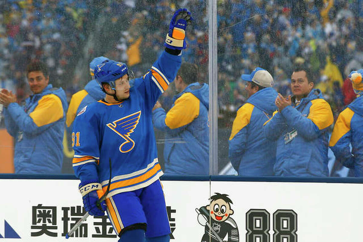 St. Louis Blues' Vladimir Tarasenko, of Russia, waves to the crowd after scoring a goal during the third period of the NHL Winter Classic hockey game against the Chicago Blackhawks at Busch Stadium, Monday, Jan. 2, 2017, in St. Louis.