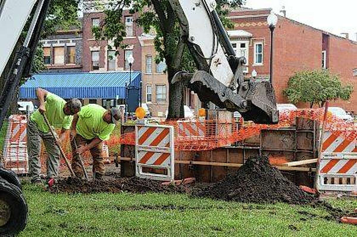 J&A Concrete Solutions workers dig a waterline Monday for a new fountain at Art Zeeck Park.