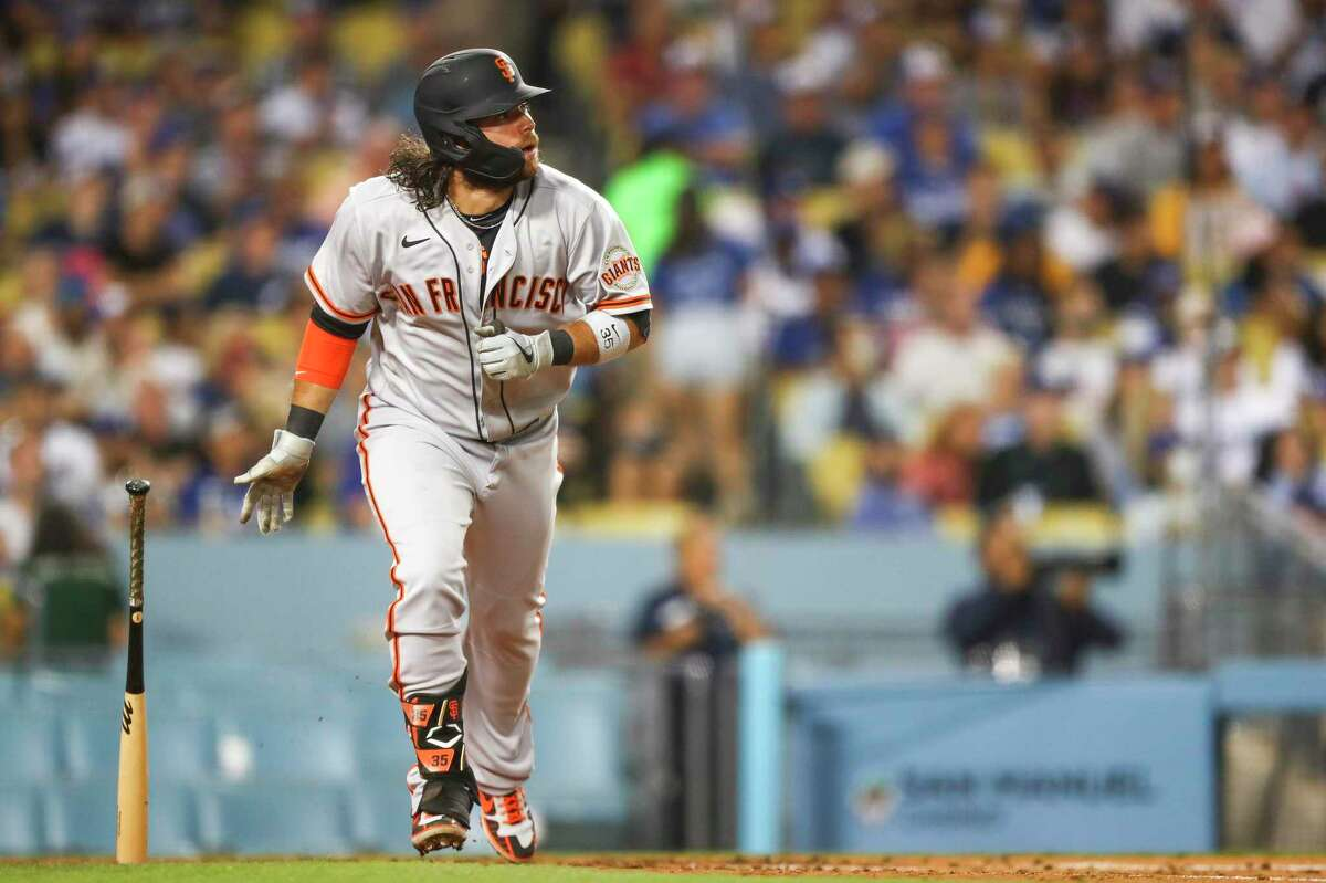 LOS ANGELES, CALIFORNIA - JUNE 28: Brandon Crawford #35 of the San Francisco Giants hits a home run in the sixth inning against the Los Angeles Dodgers at Dodger Stadium on June 28, 2021 in Los Angeles, California. (Photo by Meg Oliphant/Getty Images)