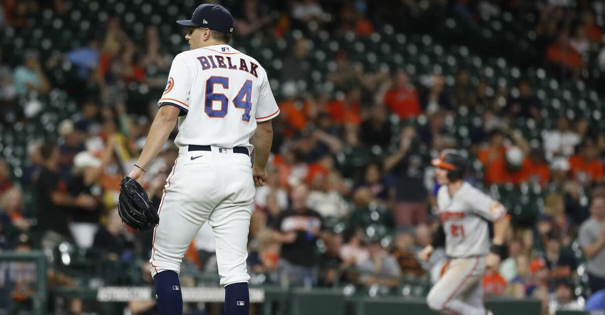 Houston Astros relief pitcher Brandon Bielak (64) reacts after giving up a two-run home run to Baltimore Orioles Austin Hays during the ninth inning of an MLB baseball game at Minute Maid Park, Monday, June 28, 2021, in Houston.