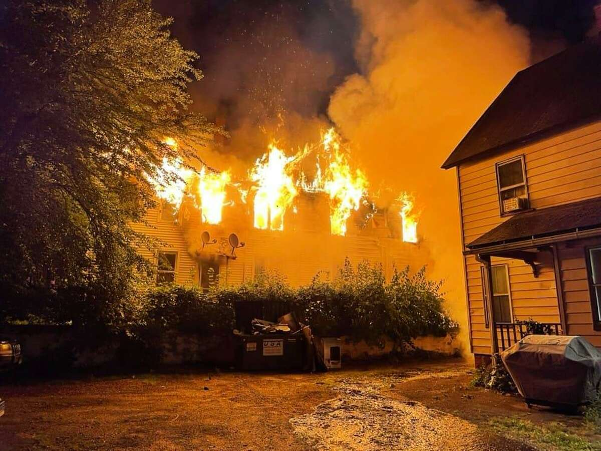 A fire at a Center Street home in Manchester, Conn., on Thursday, June 24, 2021.