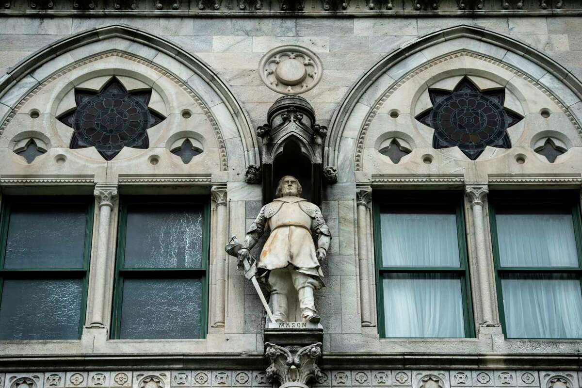 A statue of John Mason, leader of the massacre of the Pequot Tribe, on the Capitol building in Hartford.