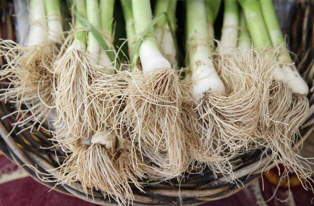 Leeks from Animal Farm are for sale Sunday, June 13, 2021, at the Heights Mercantile Farmer's Market in Houston. The farm is located in Cat Spring, about 65 miles west of Houston. Photo: Jon Shapley, Houston Chronicle / Staff Photographer / © 2021 Houston Chronicle