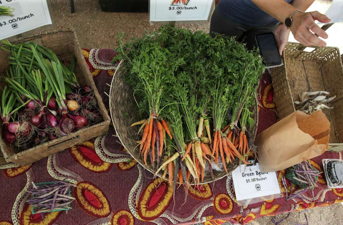 Vegetables from Animal Farm are for sale Sunday, June 13, 2021, at the Heights Mercantile Farmer's Market in Houston. The farm is located in Cat Spring, about 65 miles west of Houston.