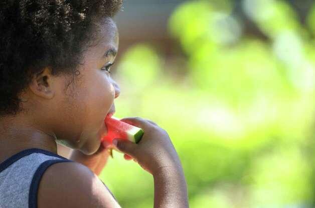 Chancellor Evans, 3, eats watermelon Sunday, June 13, 2021, at the Heights Mercantile Farmer's Market in Houston. Photo: Jon Shapley, Houston Chronicle / Staff Photographer / © 2021 Houston Chronicle