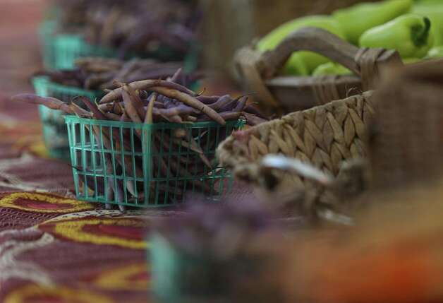Purple green beans from Animal Farm are for sale Sunday, June 13, 2021, at the Heights Mercantile Farmer's Market in Houston. The farm is located in Cat Spring, about 65 miles west of Houston. Photo: Jon Shapley, Houston Chronicle / Staff Photographer / © 2021 Houston Chronicle