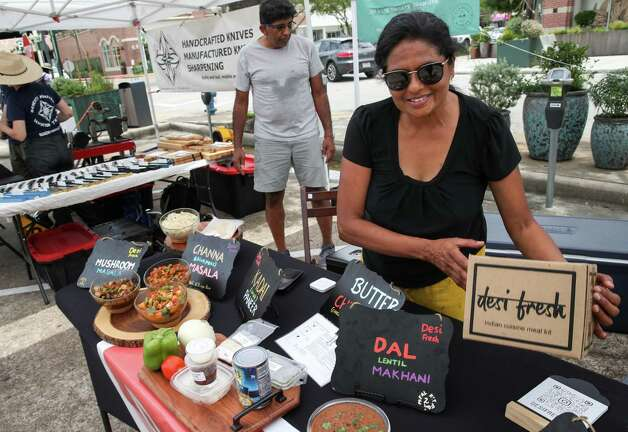Ranjani Girish shows off an Indian-food meal kit Sunday, June 20, 2021, at the Rice Village Farmers Market in Houston. She said the kit contained ingredients and instructions. Photo: Jon Shapley, Houston Chronicle / Staff Photographer / © 2021 Houston Chronicle