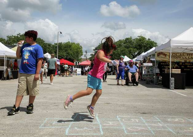 Adahlia Alvarado, 5, plays hopscotch as she and her family visited the Tomball Farmers Market -which is located at 205 West Main Street - on Saturday, June 12, 2021, in Tomball Photo: Godofredo A. Vásquez, Houston Chronicle / Staff Photographer / © 2021 Houston Chronicle