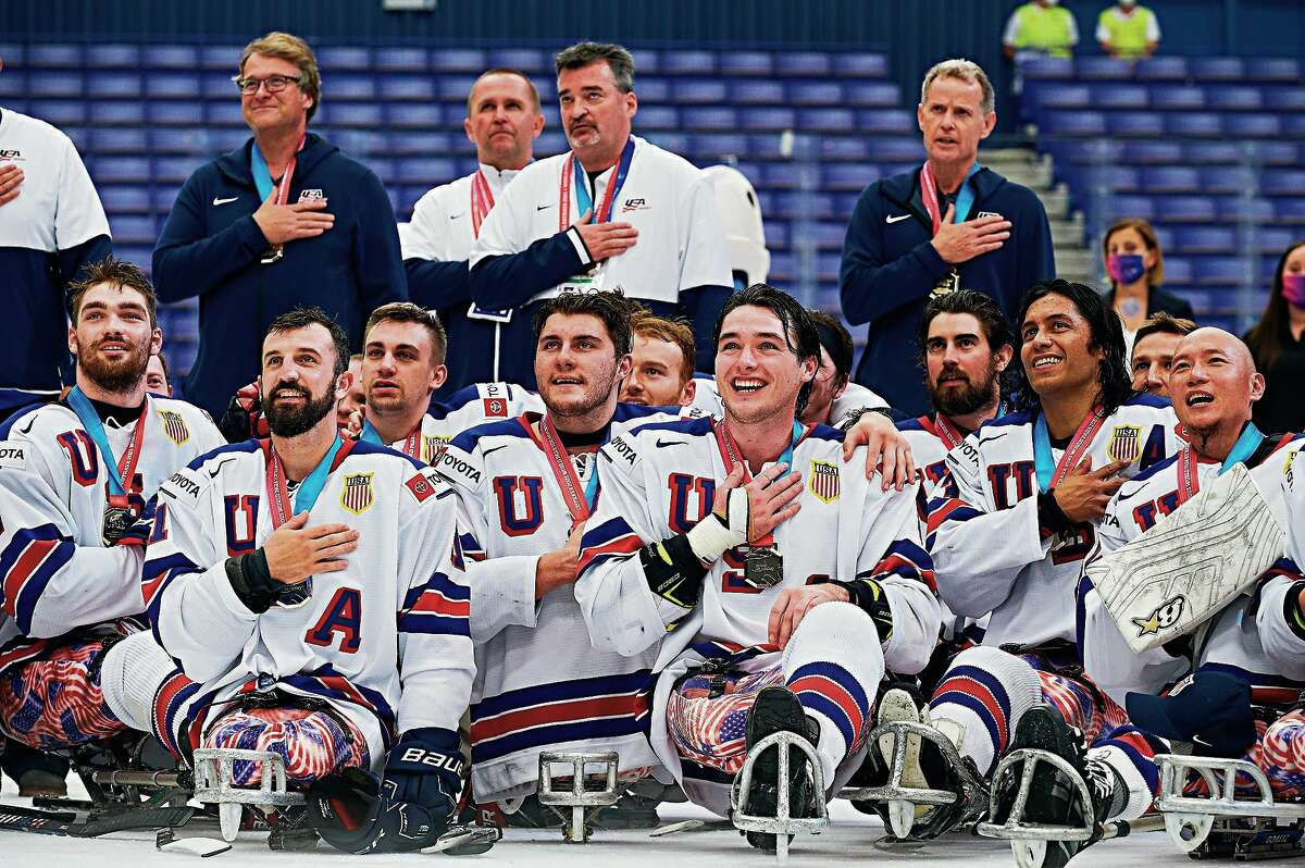 Port Hope native Joey Woodke (11) owns a gold medal after a Team USA win over Canada in the Para Ice World Championships in Czech Republic over the weekend.