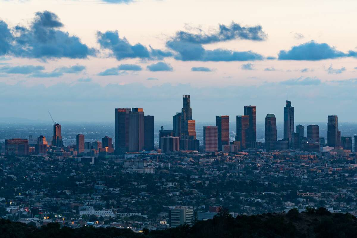A view of the Downtown Los Angeles skyline at dusk on April 26, 2021.