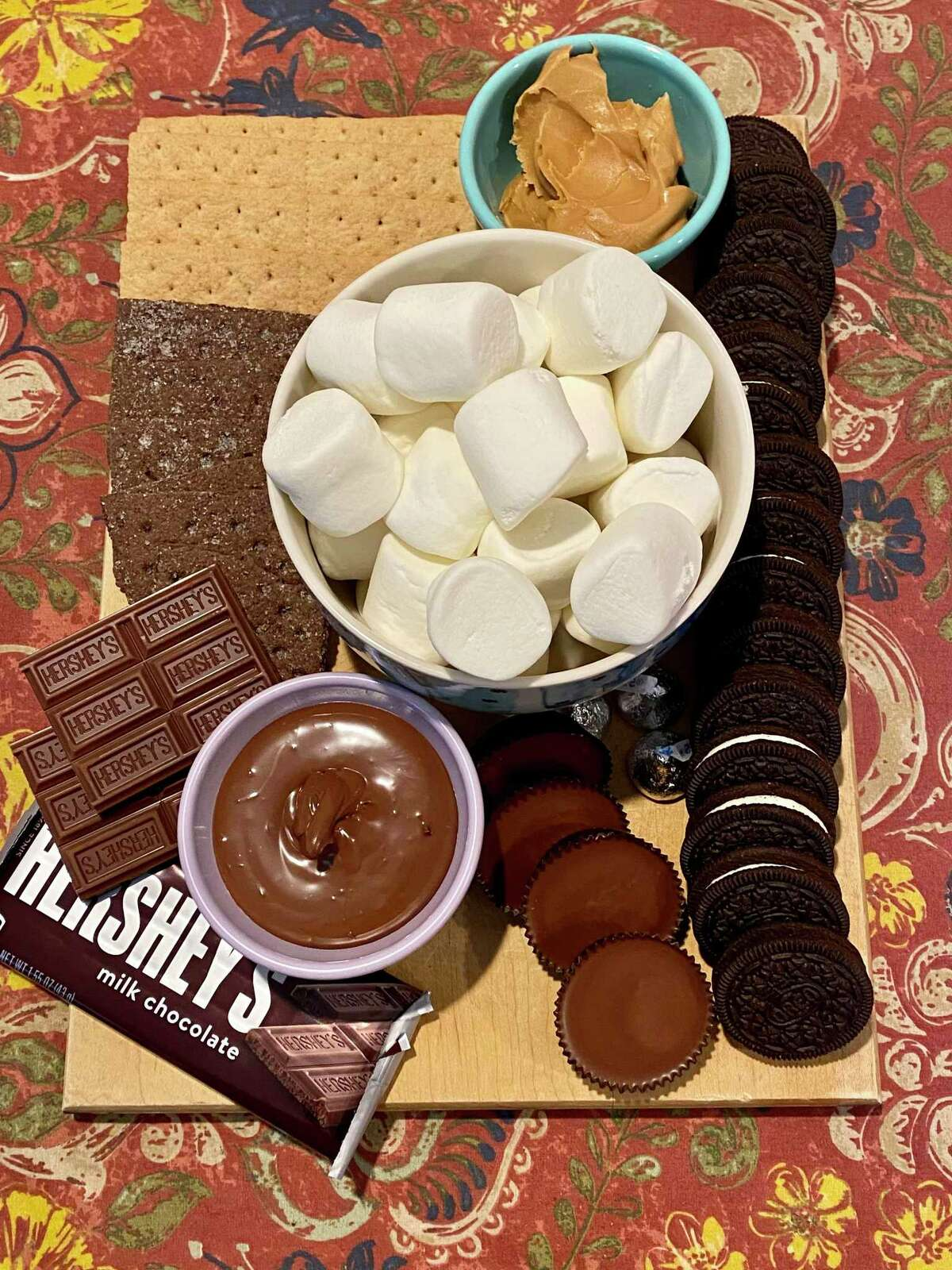 Get creative with your s'mores this summer by making a s'morgas-board.