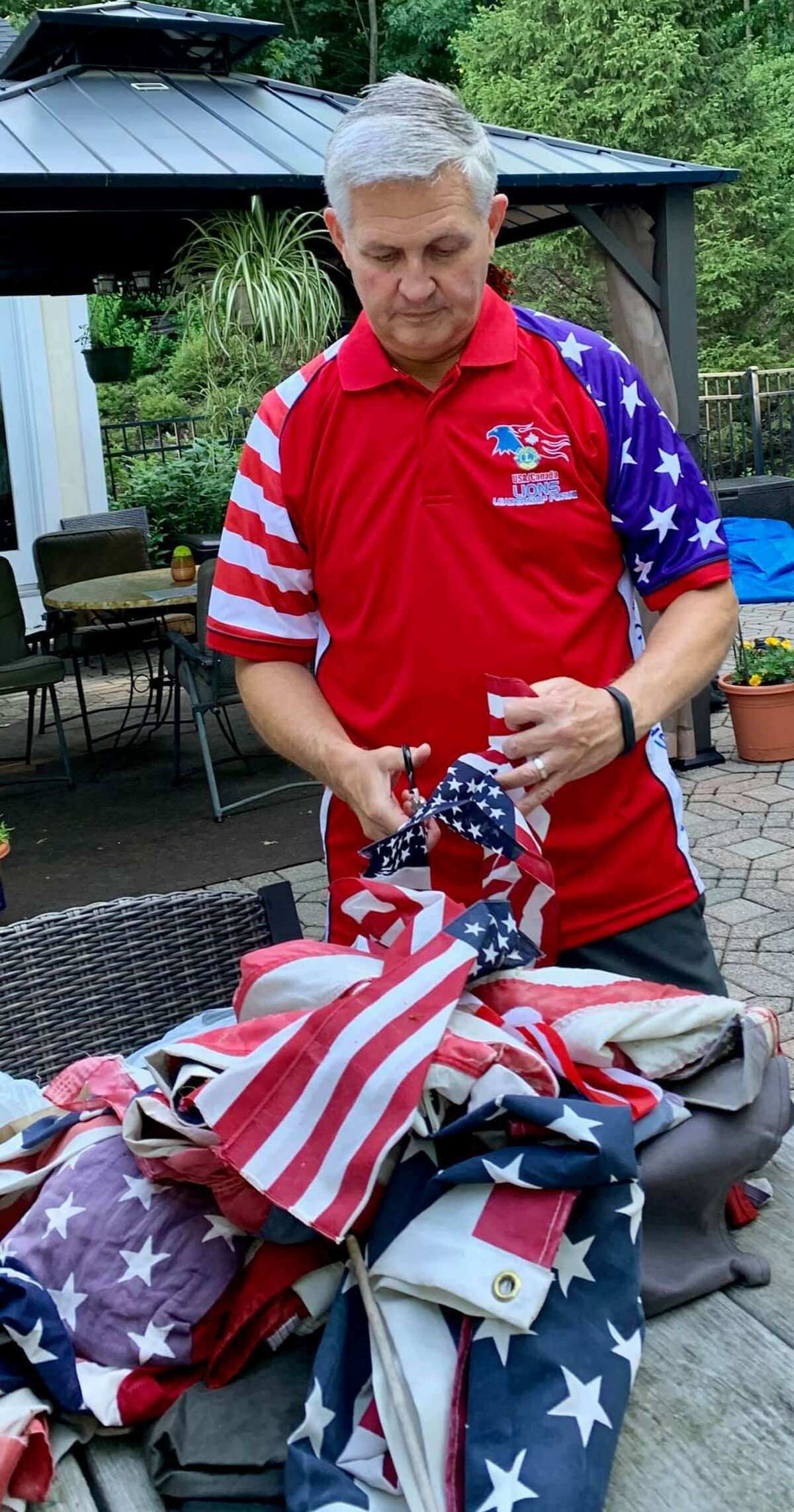 Dave Roberts with old American flags that are going to be retired