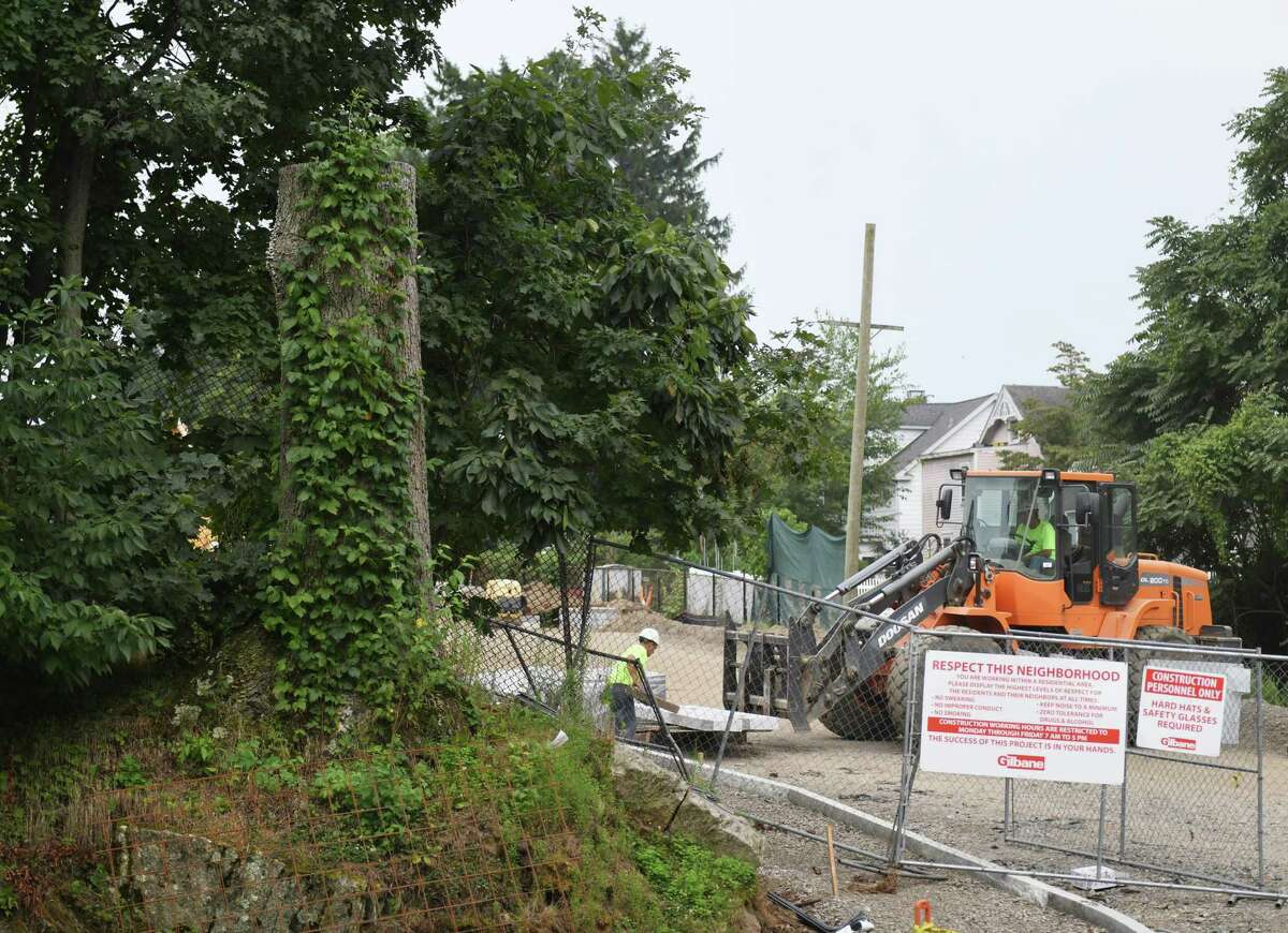 The stump of a large oak tree remains as construction continues outside the old New Lebanon School in the Byram section of Greenwich in 2019.