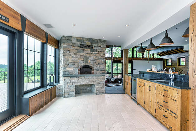 In addition to the 10-burner double range, the kitchen also has a built-in brickpizza oven. View listing Photo: Michael Bowman / Michael Bowman Photography