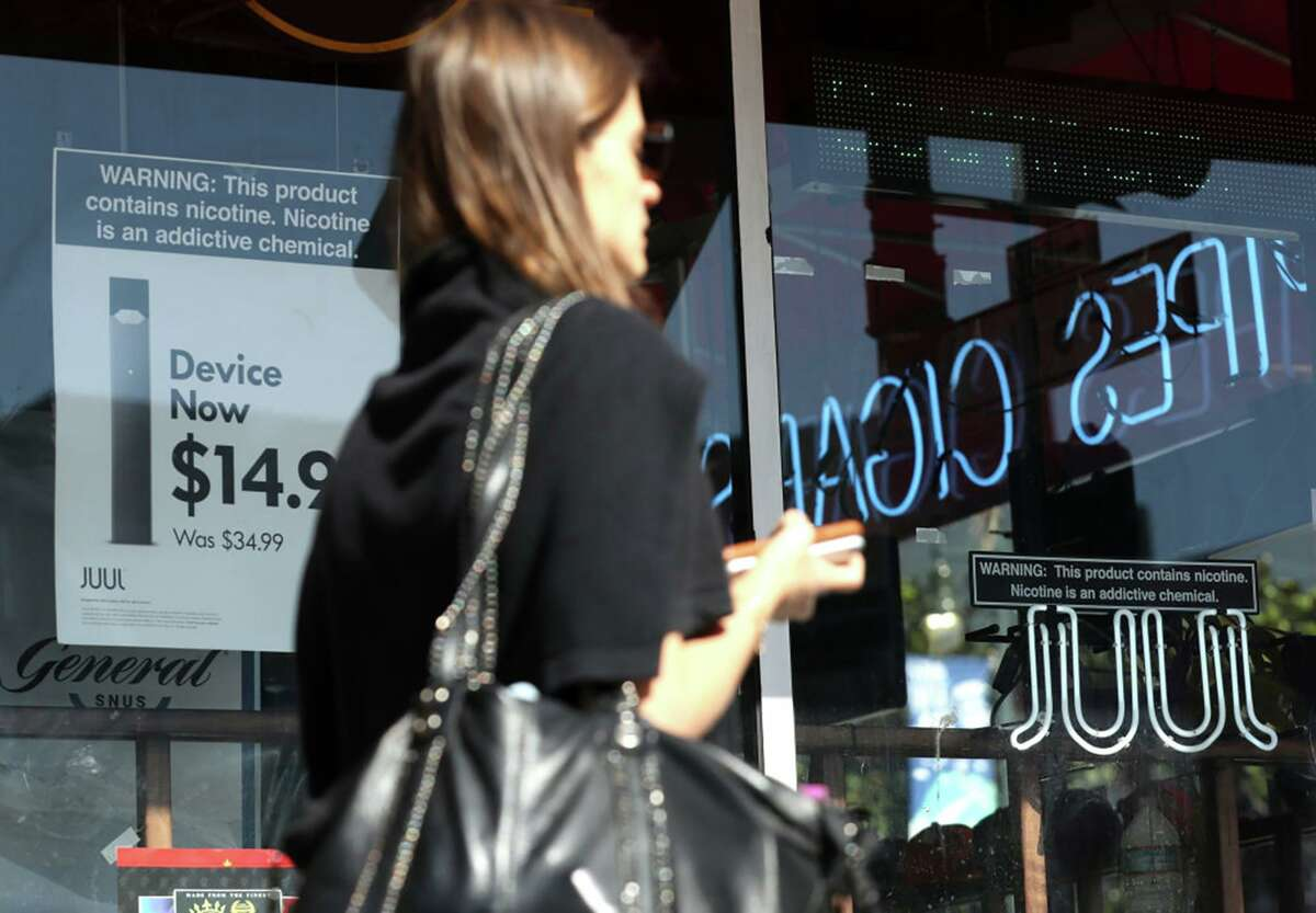 Juul products advertised in October 2019 in San Francisco. In June 2021, Juul Labs accepted a $40 million settlement with North Carolina's attorney general that sets several restrictions on the sale of its vaping devices, the first such settlement among states nationally. (Justin Sullivan/Getty Images/TNS)