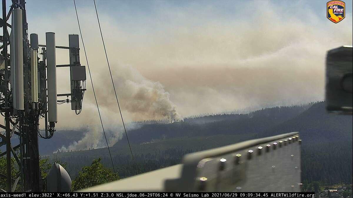 An image captured by an AlertWildfire camera showing the Lava Fire burning near Weed, Calif. The fire exploded overnight and was most recently measured at more than 13,000 acres in size.