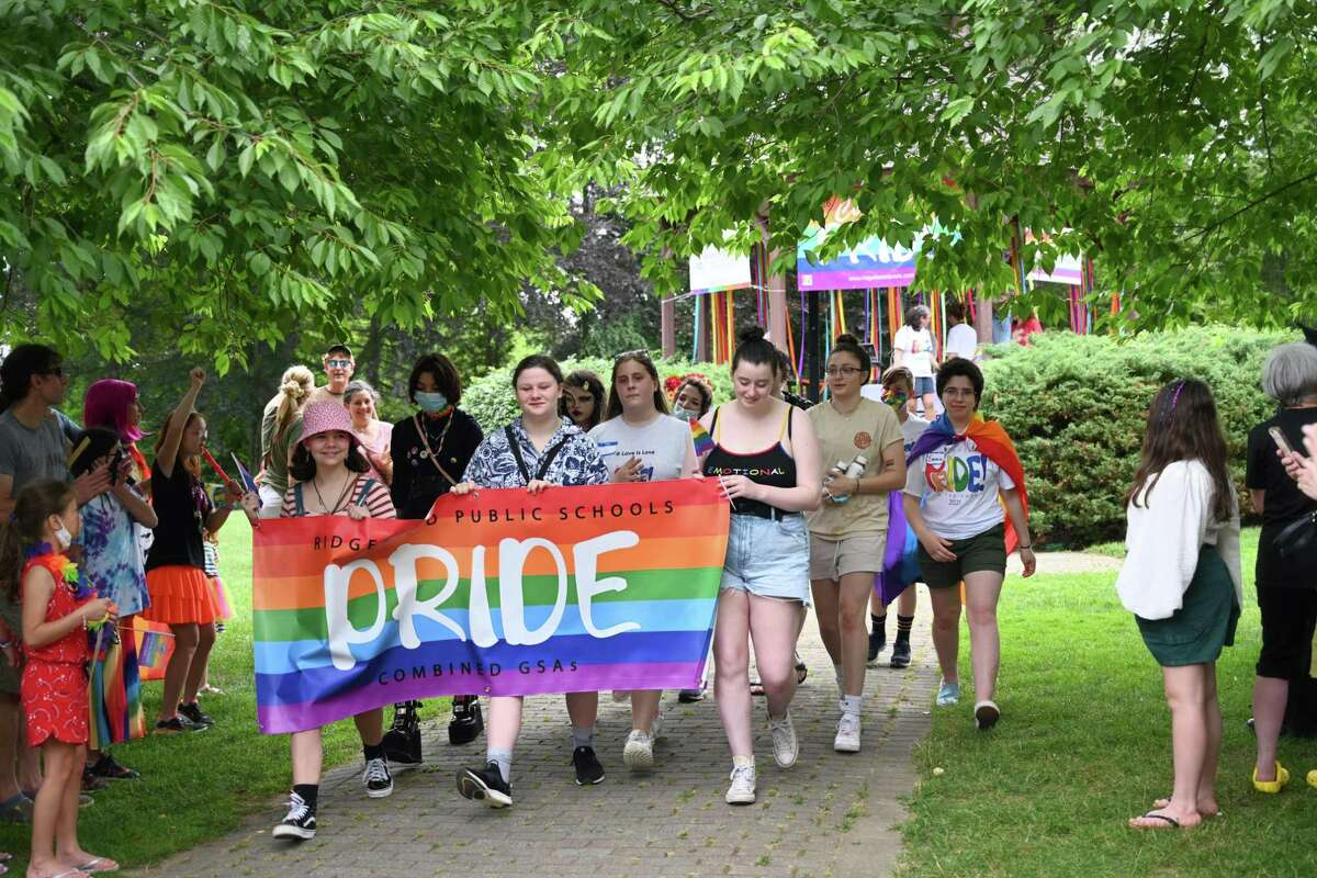 Members of Ridgefield Public Schools' Gender and Sexuality Alliance club and alumni led a march around Ballard Park in Ridgefield during the annual Pride in the Park event on June 26.