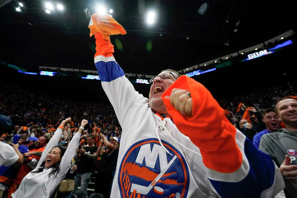 New York Islanders fans cheer after Game 6 of an NHL hockey semifinals against the Tampa Bay Lightning Wednesday, June 23, 2021, in Uniondale, N.Y. The Islanders won 3-2. (AP Photo/Frank Franklin II)